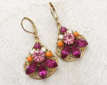 Pink, white, and orage rhinestone statement earrings on brass filigree