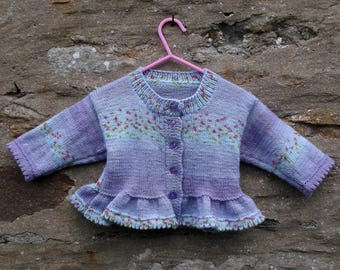 """Hand knitted girl's lilac and purple cardigan with flounced edge. 22"""" chest"""