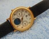 Ladies J B Champion Swiss, Moonphase style quartz watch, runs.