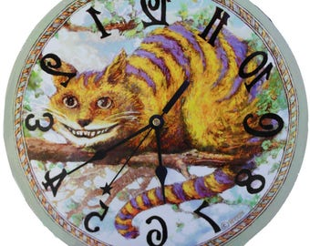 Metal Cheshire Cat clock 11 inch diameter. Runs backwards,  Alice in Wonderland Decor. A wall clock to amaze your friends.