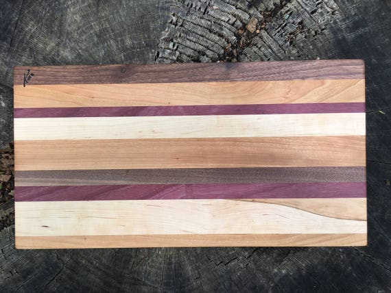 Handmade cutting board made from purple heart, cherry, maple and walnut woods