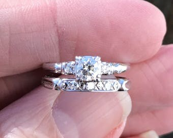 Hard to find beautiful three diamond engagment ring with matching diamond wedding band....44 point total weight....set in14 KT white gold
