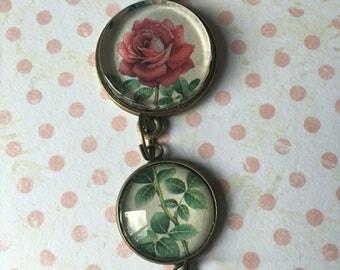 Double pendant in antique bronze coloured metal