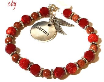 Hand Carved Red Beads Goldstone and Red Faceted Glass Beads KARMA Bracelet With Wings Charm Bracelet for her Beaded Bracelet Jewelry