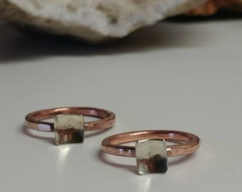 Simple hammered copper and silver ring