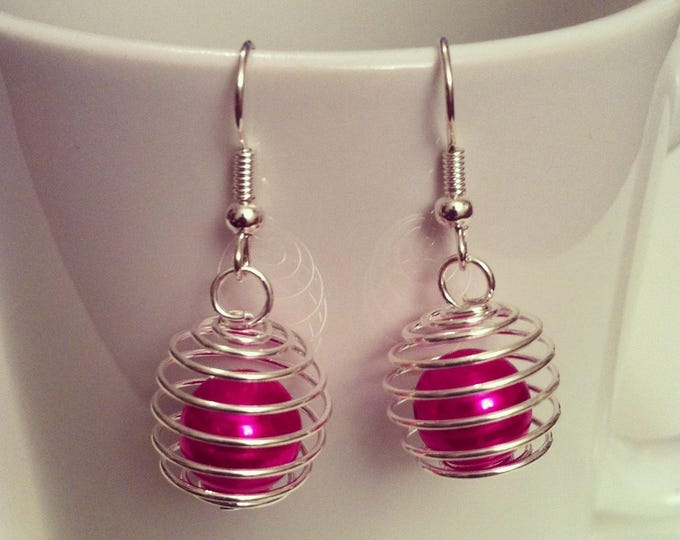 These earrings spiral beads fuchsia