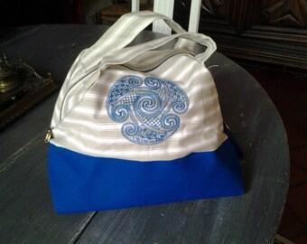 Small embroidered handle bag