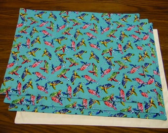 Turtles Set of 4 Placemats with Turtles Swimming on a Soft Green Background with WhiteFabric on Reverse Side