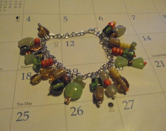 green and tan glass beads charm bracelet