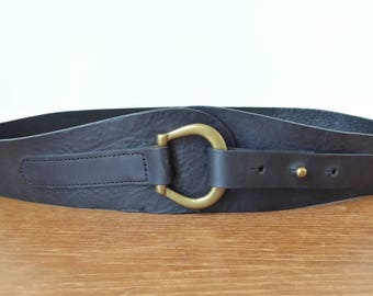 Black leather hip belt with solid brass buckle, size small