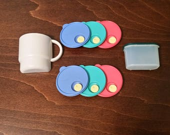 Four Tupperware Magnets