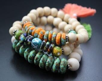 African recycled glass bracelet- recycled African bone beads bracelet - boho tribal bracelet - colorful tassel bracelet - gift for her