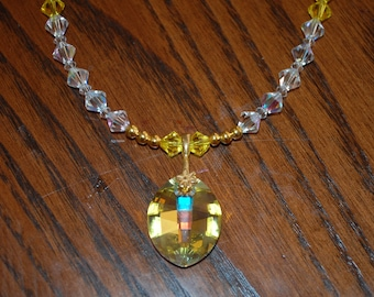 Swarovski Yellow Crystal Pendant with Clear and Yellow Swarovski Beads and Gold Spacers with Gold Toggle Clasp