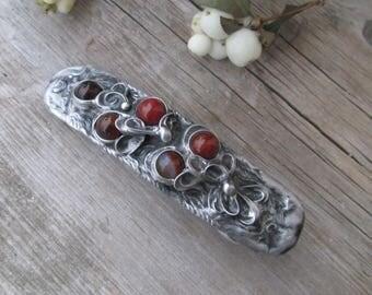metal barrette with carnelian