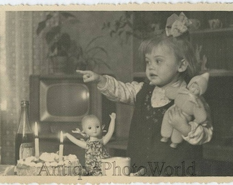 Girl w toys doll birthday celebration by TV cake with candles vintage photo