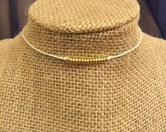 Dainty white and gold choker