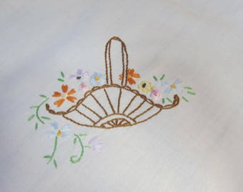 Embroidered cotton doily with swayback basket and flowers; handmade from 1920's