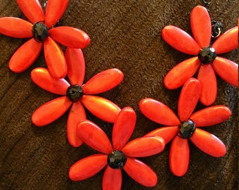 Red daisy chain necklace