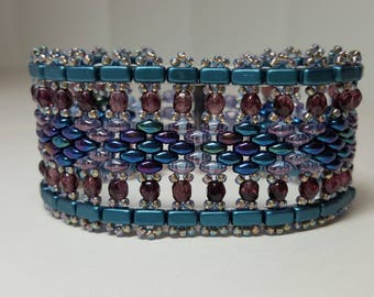 Wide cuff style bracelet in shades of blue, teal and purple