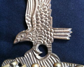 An Eagle Key Holder With A Brass Look
