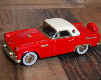 """Vintage Metal Car Friction Toy, red 1950's toy car, 10""""L x 4""""W, red and white toy car with friction mechanical drive train and rubber wheels"""