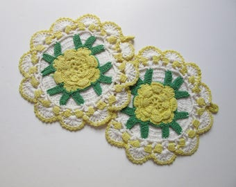 pair of crocheted pot holders / yellow roses