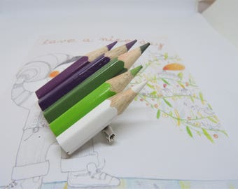 Large brooch with purple, green and white colored pencils