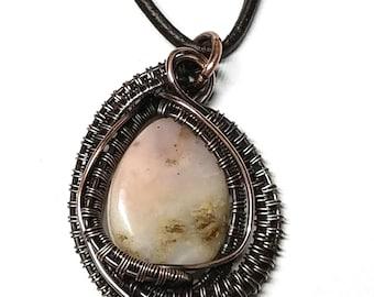 Aged wire woven copper unique handmade pendant with a Peruvian Opal stone bead