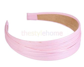 Headband covered in pink faux leather