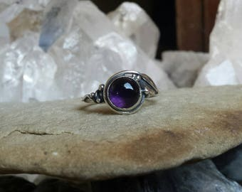 Sterling Silver Leaf Wrapped ring set with an Amethyst