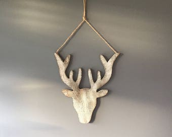 Christmas deer hanger for the wall in a wooden whitewashed style, christmas decoration, christmas deer.