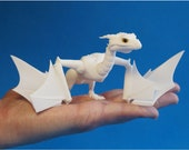In stock. The dragon is Wyvern. Height 5 cm. Length 21.8 cm.