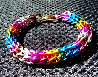 Spectrum: foxtail weave chainmaille bracelet in multi-colored anodized aluminum.