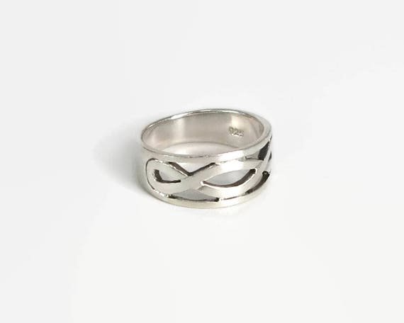 Sterling silver infinity ring, band with open infinity symbol on the front, size N.5 / 7