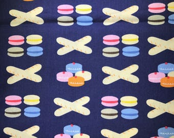 Fabric with bakery products.  Cupcakes. Loaf of Bread