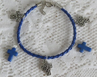Blue braided bracelet with cross charms
