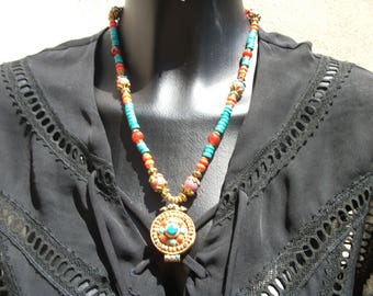 Necklace pendant: ghau vermeil inlaid turquoise and coral.