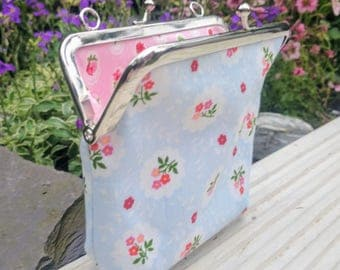 Light Blue coin purse with Cath Kidston style fabric.  Silver coloured kiss lock snap frame.  Pink floral Cath Kidston style fabric lining.