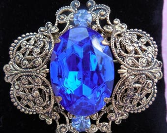20% OFF SALE 1950s Vintage Brooch with Huge Sapphire Emerald Cut Rhinestone Filigree Design