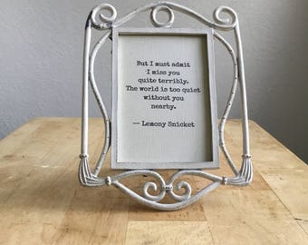 but I must admit i miss you quite terribly the world is too quiet without you nearby lemony snicket typed framed quote picture ornate metal