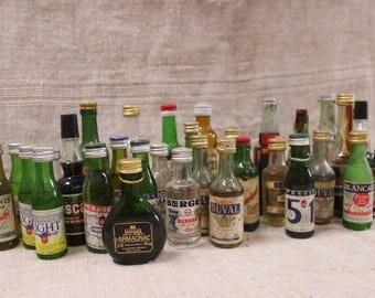 Sample bottles of various French liquors