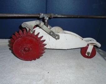 Cast iron lawn sprinkler. Tractor sprinkler. Vintage sprinkler.