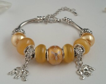 Yellow charms bracelet with elephants ref 413