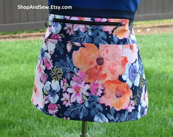 """Vendor apron *1, plus size for 10"""" tablet with 4 pockets, one has zipper for money. Multi floral on blue background fabric. Gardener, server"""