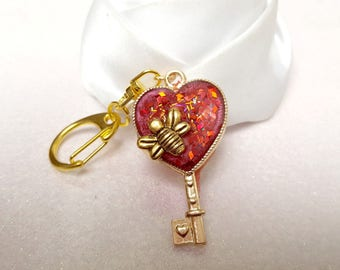 red glitter key keychain and his little bee