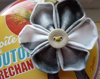 Kanzashi flower brooch in grey and white fabric with small grey button