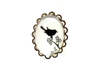 Ring bronze black bird and branch on white background