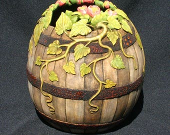 Hand Carved Gourd with Weathered Look and Vines and Flowers