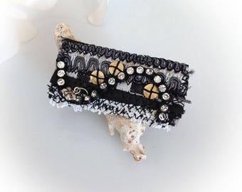 Brooch, textile, black, white, rectangular art