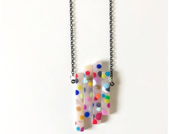 Polka dot pendant - handmade with polymer clay hung on oxidized black nickel free chain